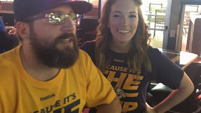 Keith Jones wears his special Predators shirt while watching a playoff game with Maggie Jones at O'Neals.