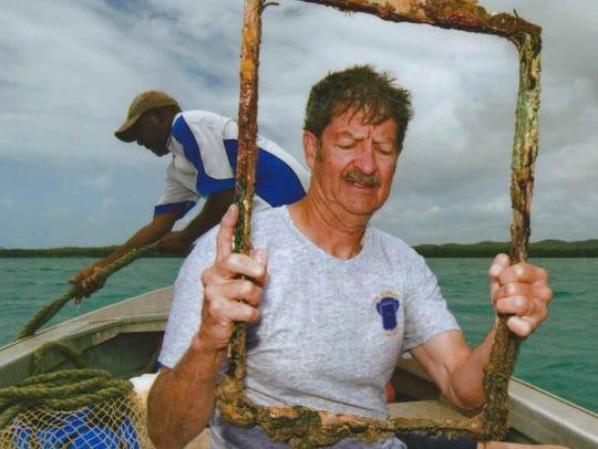 Retired teacher Ken Elder Bledsoe holds part of the