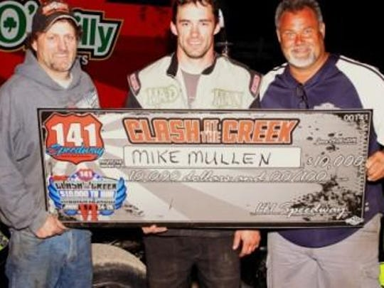 2014 Clash at the Creek winner Mike Mullen (center) is flanked by his dad Brian Mullen (left) and car owner Ricky Lemmen (right) in victory lane at 141 Speedway in Francis Creek following the $10,000 dollar win last June.