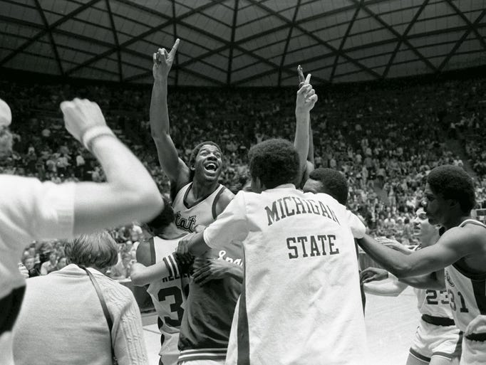 Michigan State's Earvin (Magic) Johnson raises his