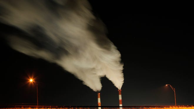 FILE - In this Jan. 19, 2012 file photo, smoke rises in this time exposure image from the stacks of the La Cygne Generating Station coal-fired power plant in La Cygne, Kan. This year the nation's weather has been hotter and more extreme than ever, federal records show. Yet there are two people who aren't talking about it, and they both happen to be running for president. In 2009, President Barack Obama proposed a bill that would have capped power plant carbon dioxide emissions and allowed trading of credits for the right to emit greenhouse gases, but the measure died in Congress. (AP Photo/Charlie Riedel, Filr)