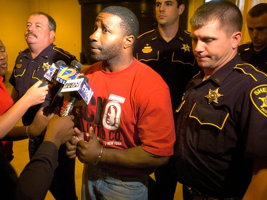 File photo: Triple homicide suspect Robert McCoy is brought into the Bossier Maximum Security Facility.