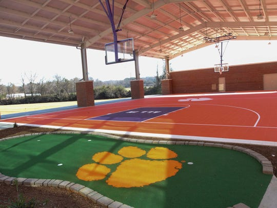 The outdoor village of Clemson's Allen N. Reeves Football Complex includes miniature golf and a covered basketball court.