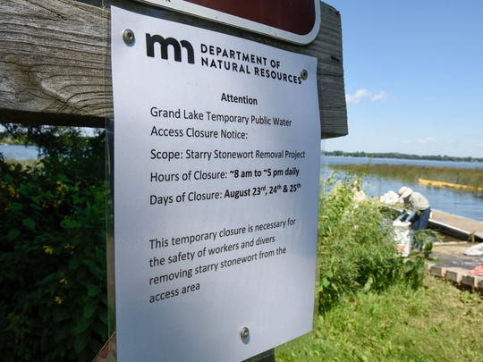 A sign announces work underway to remove starry stonewort from  the public access area Wednesday, Aug. 23, at Grand Lake.