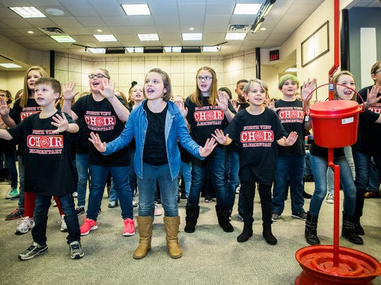 The North View Elementary School choir sings Christmas music for the Red Kettle Campaign kick-off at the Muncie Mall Saturday afternoon. The Salvation Army is attempting to raise $160,000 for its 2018 services.
