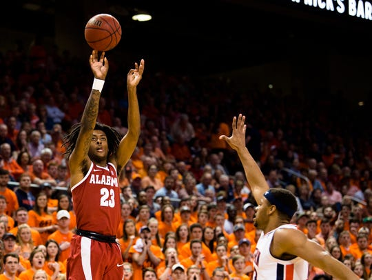 Alabama Crimson Tide guard John Petty (23) shoots a