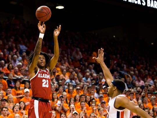 Alabama Crimson Tide guard John Petty (23) shoots a