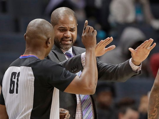 Memphis Grizzlies coach J.B. Bickerstaff, right, argues a call with referee Courtney Kirkland during the first half of the team's NBA basketball game against the Charlotte Hornets in Charlotte, N.C., Thursday, March 22, 2018. (AP Photo/Chuck Burton)