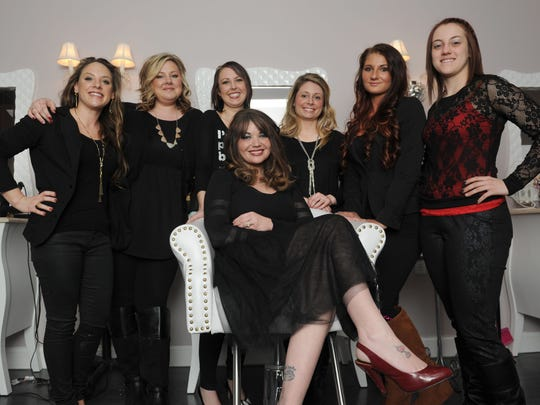 Owner Jessica Hennessey, center, and her team at La Bella Vita, from left, Jackie Matheney, Kristy Peyton, Brooklyn Rasor, Lauren Rizor, Shania Weaver and Chelsey Mohler, pose for a photo Friday inside the Zanesville salon, located on McIntire Avenue. The salon, which opened Jan. 1, offers services such as an aromatherapy oxygen bar, blow dry service, milk baths and aesthetician services.