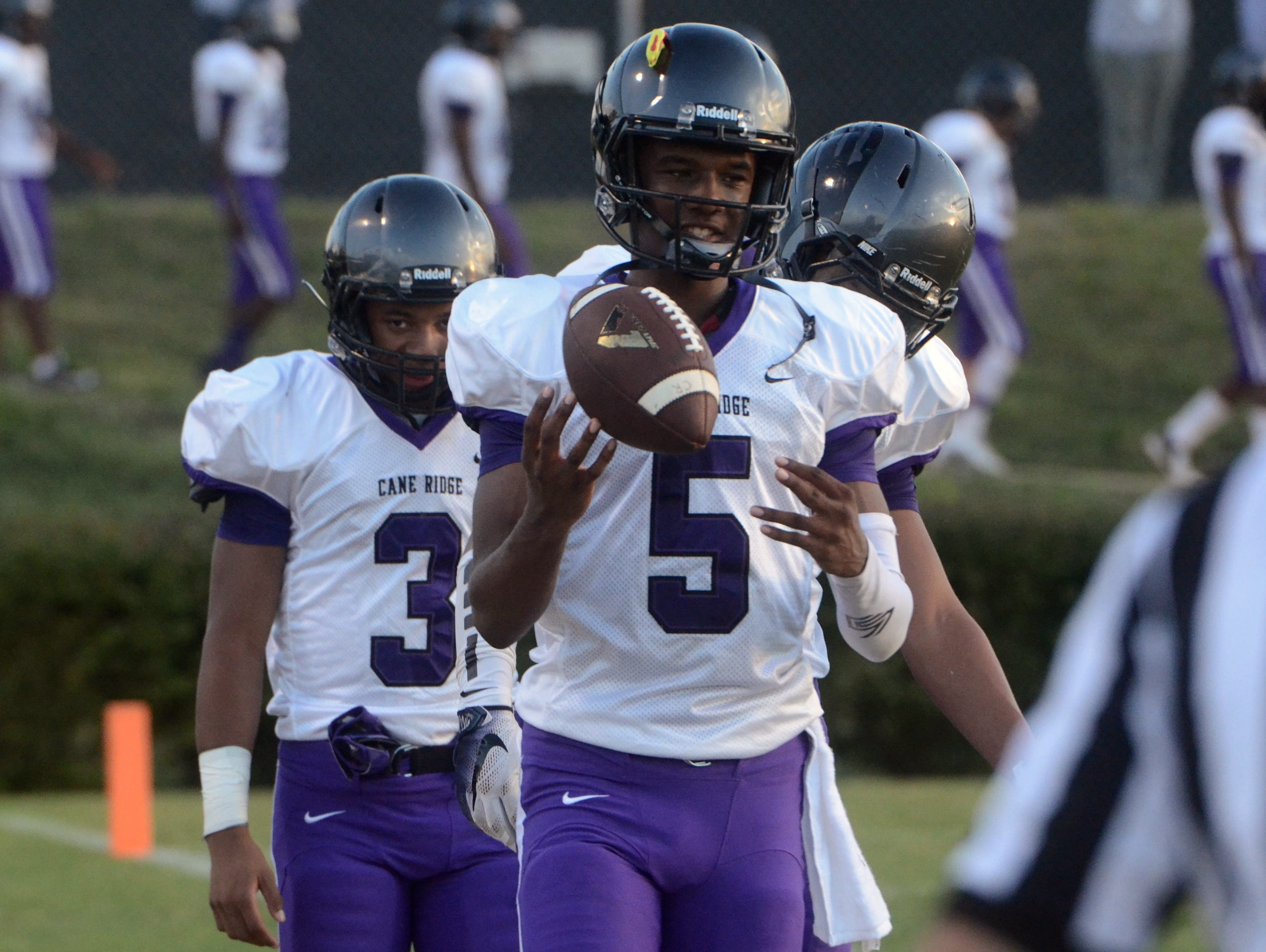 Cane Ridge captains D.J. Thorpe (5), Brandon Lewis (3) and Jordan Bell take the field prior to last Thursday's win over Mt. Juliet.