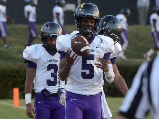 Cane Ridge quarterback D.J. Thorpe (5) and the unbeaten Ravens will actually be the underdogs in Friday's Class 5A quarterfinal matchup with Independence.