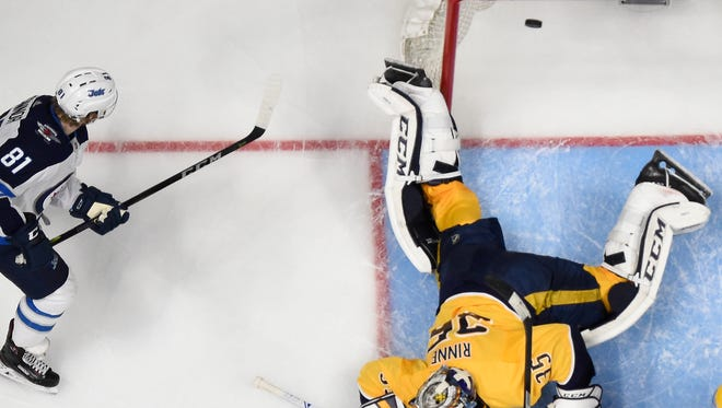 Predators goaltender Pekka Rinne (35) fails to stop a shot by Jets left wing Kyle Connor (not shown) in the second period of Game 5 on Saturday.