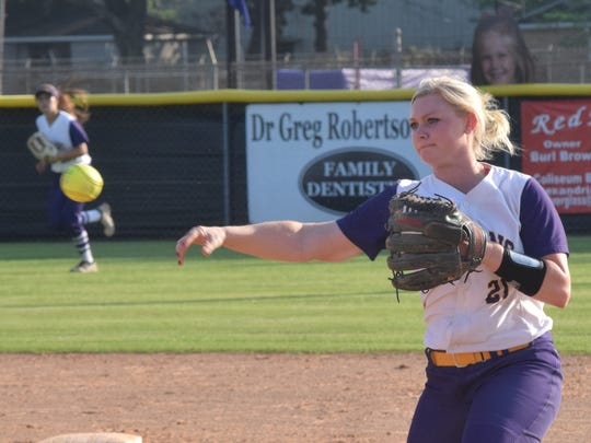 ASH's Madyson Carruth (21) throws to first against