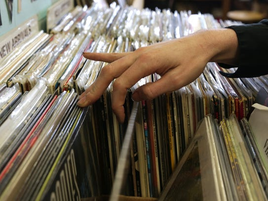 A customer looks through various vinyl records inside