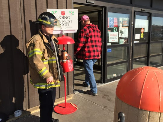 Jeremiah Parker, with the Stevens Point Fire Department, rings bells for the Salvation Army Saturday at Fleet Farm in Stevens Point.