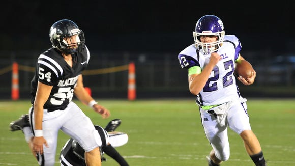 Mitchell and Ben Young (22) are 4-1 after Friday's 27-26 loss at North Buncombe.
