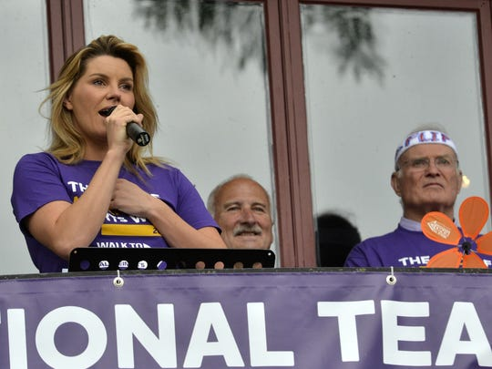 Grace Potter, left, a Vermont-born singer and songwriter, speaks during the opening ceremony of the Walk to End Alzheimer's at the Shelburne Museum on Sunday, Sept. 18, 2016, as Greg Lothrop and Walt Gundel look on.