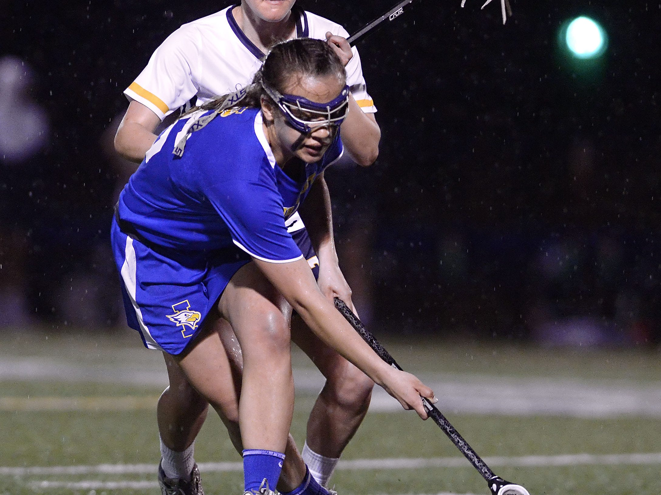 Irondequoit's Celoina Alvarado, front, scoops up the ball in front of Webster Thomas' Gabriella Vasile.