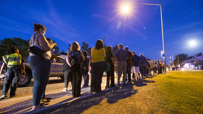 Voters wait in line to cast their ballots at Pilgrim Evangelical Lutheran Church in Mesa in 2016. Lines in the evening were around three hours.