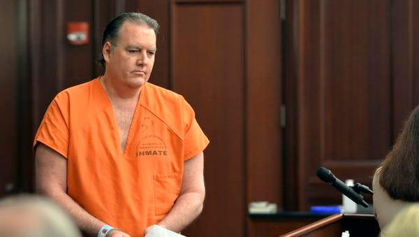 FILE PHOTO: Michael Dunn returns to his seat after reading his statement, which included an apology to the Davis family, during his sentencing hearing Friday, Oct. 17, 2014 at the Duval County Courthouse in Jacksonville, Fla. Dunn, convicted of first-degree murder in a retrial in September for fatally shooting 17-year-old Jordan Davis in November 2012 in an argument over loud music outside a Florida convenience store was sentenced to life in prison without parole. (AP Photo/The Florida Times-Union, Bruce Lipsky, Pool)