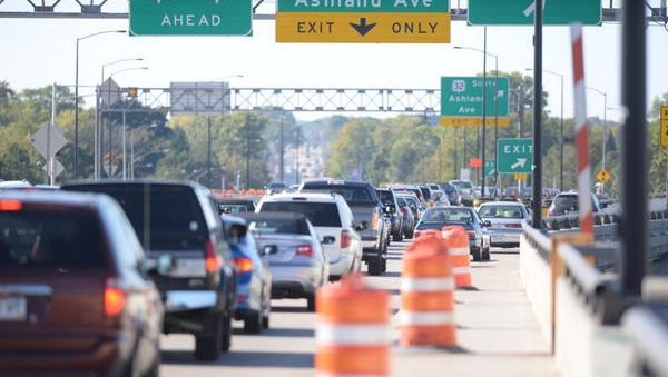 Traffic is backed up on the Mason Street bridge after a crash involving two Green Bay police squad cars.