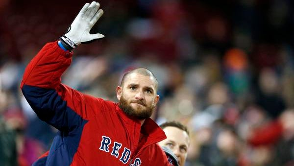 Boston Red Sox's Jonny Gomes watches a foul ball by teammate A.J. Pierzynski in the ninth inning of a baseball game against the Baltimore Orioles in Boston, Friday, April 18, 2014.