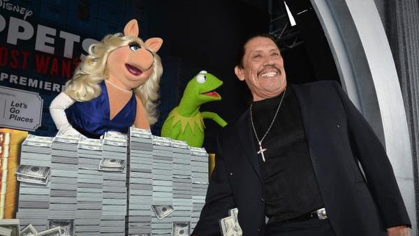 """Miss Piggy, Kermit and actor Danny Trejo arrive for the premiere of Disney's """"Muppets Most Wanted"""" at the El Capitan Theatre on March 11."""