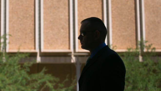 Defendant Jason Lee stands outside the Maricopa County Superior Court in Phoenix on Aug. 4, 2014.