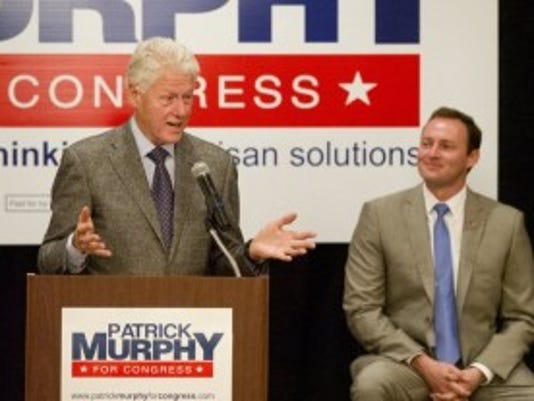 "Former President Bill Clinton stumps for U.S. Rep. Patrick Murphy Sunday at the Marriott Hotel in Palm Beach Gardens. His appearance was part of the ""Get Out the Vote"" campaign. (MOLLY BARTELS/TREASURE COAST NEWSPAPERS) To see more photos, go to TCPalm.com"