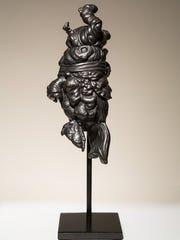 "McArthur Freeman II exhibits ""Pine App,"" a sculpture"