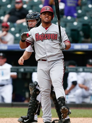 Jun 25, 2015: Arizona Diamondbacks right fielder Yasmany Tomas (24) reacts after striking out swinging to end the game in the ninth inning against the Colorado Rockies at Coors Field. The Rockies defeated the Diamondbacks 6-4.