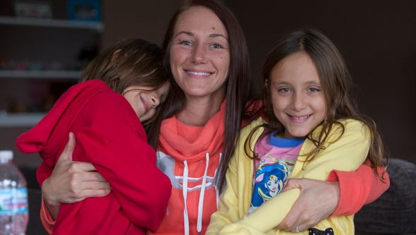 Kelly Agnew, with daughters Kassidy Omran (left), and