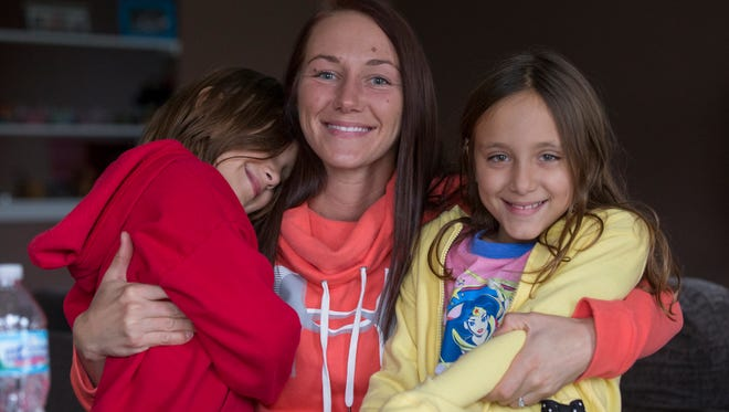 Kelly Agnew, with daughters Kassidy Omran (left), and Adallee Omran, Wednesday, Nov. 1, 2017. Agnew is getting over a multi-year opioid addiction.