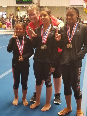 A group of local gymnasts recently qualified for a regional competition.