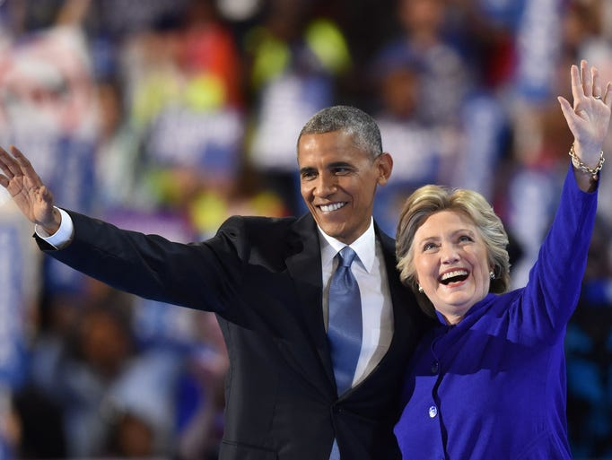 President Barack Obama waves with Democratic presidential