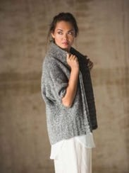 The Falmouth Cardigan has short sleeves and is knitted
