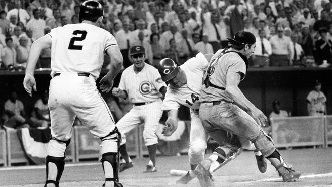 Pete Rose slams into Cleveland Indians catcher Ray Fosse to score a controversial game-winning run in the 1970 All-Star Game.