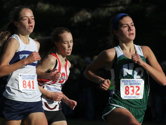 Green Bay Notre Dame's Maria Ehlinger, right, finishes
