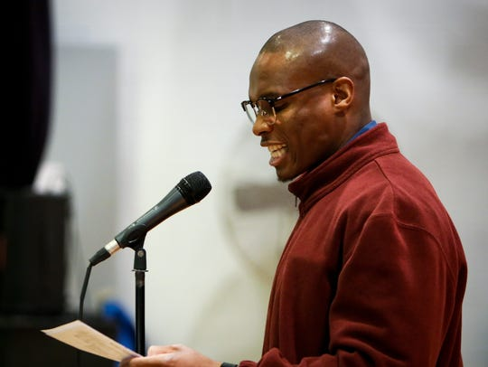 Prison inmate Diarra Bryant reads a poem Tuesday, Dec..