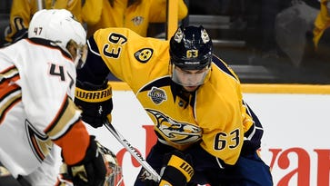 Predators center Mike Ribeiro (63) tries to move the puck defended by Ducks defenseman Hampus Lindholm (47) during the first period at Bridgestone Arena Tuesday April 19, 2016, in Nashville, Tenn.