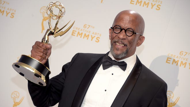 "487985118.jpg LOS ANGELES, CA - SEPTEMBER 12:  Reg E. Cathey, winner of the award for guest actor in a drama for ""House of Cards,"" poses in the press room during the 2015 Creative Arts Emmy Awards at Microsoft Theater on September 12, 2015 in Los Angeles, California.  (Photo by Jason Kempin/Getty Images)"