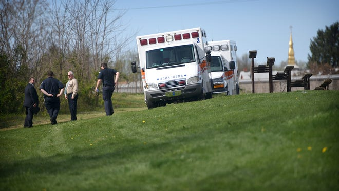 Ambulance crews arrive to carry away the victim of a gunshot. City police were dispatched to Beautex Park Tuesday afternoon to investigate the report of a gunshot victim.