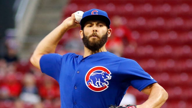 Cubs starting pitcher Jake Arrieta throws against the Reds during the first inning at Great American Ball Park.