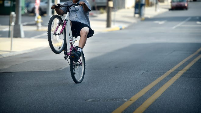 The Lebanon Police Department is cracking down on bicycle riders who are not following the traffic laws. Citizen complaints have prompted the police to take action. An unidentified cyclist rides north on Eighth Street, between Chestnut and Cumberland.