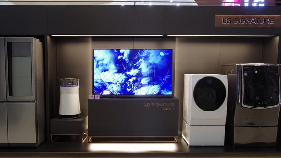 The LG Signature lineup includes an upscale refrigerator, air purifier, OLED TV, and washing machines.