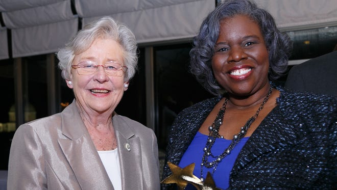 Gov. Kay Ivey, left, recently announced that Zestlan Simmons, right, was named the Teacher of the Year for 2018-2019. Simmons teaches advanced placement English at Booker T. Washington Magnet High School in Montgomery.