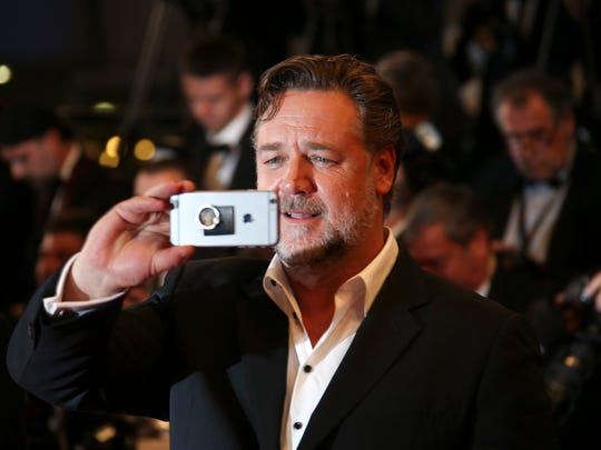Actor Russell Crowe poses for photographers upon arrival