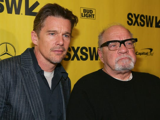 Ethan Hawke, left, and director Paul Schrader arrive