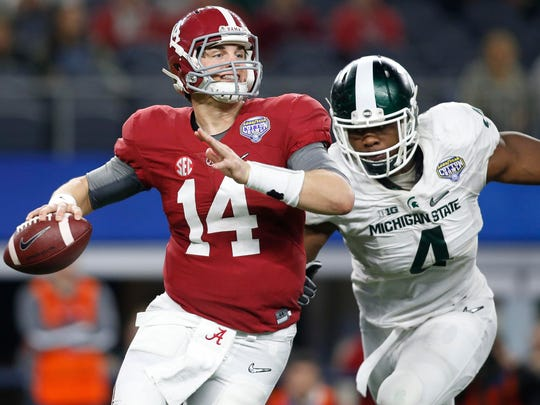 Alabama quarterback Jake Coker looks to throw against