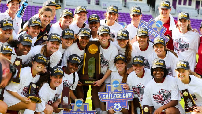 Stanford players pose for a photo after defeating UCLA in the NCAA women's soccer College Cup championship at Orlando City Stadium.
